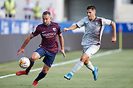 David Ferreiro of SD Huesca competes for the ball with Alvaro Tejero of SD Eibar during the La Liga Smart Bank match that will face SD Huesca and SD Eibar at El Alcoraz on Aug 13, 2021 in Huesca, Spain.