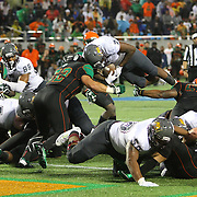 Bethune Cookman running back Danny Dillard (7) gets stopped by Florida A&M Rattlers linebacker William Helms (52) as he attempts to jump over the goal line during the Florida Classic NCAA football game between the FAMU Rattlers and the Bethune Cookman Wildcats at the Florida Citrus bowl on Saturday, November 22, 2014 in Orlando, Florida. (AP Photo/Alex Menendez)