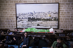 April 14, 2018 - Gaza City, Gaza Strip - Relatives of 28-year-old Palestinian Islam Herzallah, who was shot by Israeli troops east of Gaza City and transported to a hospital where he died, mourns over his body during his funeral. Islam's death brings to 34 the number of Palestinians killed in two weeks of protests and clashes along Gaza's border with Israel. (Credit Image: © Mahmoud Issa/Quds Net News via ZUMA Wire)