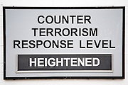 'Counter terrorism response level heightened' sign on British Royal Navy military base, HMNB Portsmouth, Hampshire, UK.