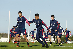 (L-R), Noussair Mazraoui of Ajax, David Neres of Ajax, Leon Bergsma of Ajax during a training session of Ajax Amsterdam at the Cascada Resort on January 08, 2018 in Lagos, Portugal