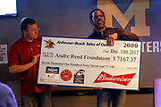 SHOT 12/10/17 1:28:45 PM - Former Buffalo Bills wide receiver and Hall of Fame player Andre Reed signs autographs and meets with fans at LoDo's Bar and Grill in Denver, Co. as the Buffalo Bills played the Indianapolis Colts that Sunday. Reed played wide receiver in the National Football League for 16 seasons, 15 with the Buffalo Bills and one with the Washington Redskins. (Photo by Marc Piscotty / © 2017)