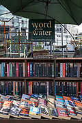 Word on the Water along Regents Canal towpath on the 9th October 2019 in London in the United Kingdom. Word on the Water is a bookshop on a barge boat moored on the regents canal near Kings Cross and St Pancras development.
