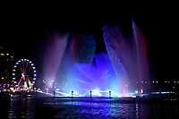 Water performance at Darling Harbour with reflections at Night with colourful display