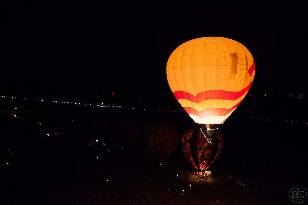 """Dawn Patrol Lift Off"" - Photograph of a hot air ballon lifting off for Dawn Patrol at the 2012 Great Reno Balloon Racke. Photographed from a hot air balloon."