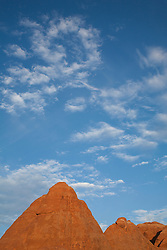 North America, United States, Utah, Arches National Park, clouds and sandstone butte on Devils Garden Trail