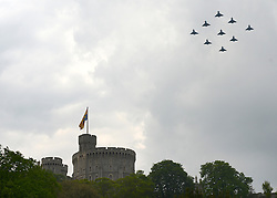 © Licensed to London News Pictures. 19/05/2012. WIndsor, UK A diamond shaped flypast over Windsor Castle. Armed Forces muster and parade in Windsor today , 19th May 2012, in tribute to Her Majesty the Queen for the Diamond Jubilee. 2,500 troops paraded through the town before the Queen and Duke of Edinburgh to mark the Diamond Jubilee. Once the parade has passed the Queen and Duke traveled along the same route to an arena within Home Park, where the troops mustered. A tri-service flypast of 78 aircraft, including helicopters, Hawks, the Battle of Britain Memorial Flight, the Red Arrows and Tornados went overhead. Photo credit : Stephen Simpson/LNP