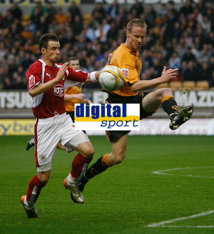 Photo: Steve Bond/Sportsbeat Images.<br /> Wolverhampton Wanderers v Bristol City. Coca Cola Championship. 03/11/2007. Darren Ward (R) clears in front of Michael McIndoe (L)