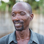 CAPTION: Stanislas is 50 years old now; he was selected as a Concern Worldwide Graduation Programme beneficiary in 2011. He was among the earliest beneficiaries of the programme, and was chosen as he was among the poorest of the poor in his community. He and the other beneficiaries were selected through a meeting of authority figures, community men and women. Stanislas is very grateful that he was part of the first cohort of the programme, which covered the poorest 10% from a community of 2,000 households. He feels that participating in the programme has brought significant positive changes in his life. LOCATION: Rushikiri Village, Kimuna Cell, Rusatira Sector, Huye District, South Province, Rwanda. INDIVIDUAL(S) PHOTOGRAPHED: Stanislas Iriboneye.