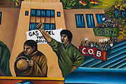 Bolivia June 2013. La Paz. Part of a wall painting showing workers and words saying 'Gas for the people'.
