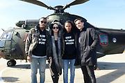 Vertrek van de ambassadeurs van de Vrijheid vanaf vliegbasis Gilze Rijen . De Ambassadeurs van de Vrijheid zullen dankzij de inzet van Defensie optreden op de veertien Bevrijdingsfestivals. <br /> <br /> OP de foto / On the photo:  Sunnery James , Sharon Kovacs, Ryan Marciano en Nielson voor de helikopter.