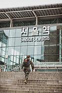 A South Korean Marine walks up the steps toward Seoul Station, the main train station in the South Korean capital. (September 27, 2019)