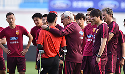 June 6, 2017 - Guangzh, Guangzh, China - Guangzhou CHINA-June 6 2017: (EDITORIAL USE ONLY. CHINA OUT) ..Marcello Lippi and China national football team meet with the one-legged football player He Yiyi before International Football Friendship Match in Guangzhou, south China's Guangdong Province, June 6th, 2017. (Credit Image: © SIPA Asia via ZUMA Wire)