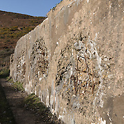 Shell damage to concrete block structure used in WW2 as preparation for Operation Neptune, the amphibious assault of mainland Western Europe. Ragwen Point near Pendine, Dyfed.