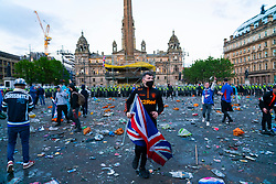 Glasgow, Scotland, UK. 15 May 202. Rangers football supporters  celebrating 55th league victory are cleared from George Square by police in riot gear on Saturday evening. In very violent scenes police were pelted with bottles and items from a nearby construction site as police pushed the supporters into the south west corner of the square.  Iain Masterton/Alamy Live News.