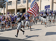 MANHATTAN, KS - SEPTEMBER 27:  Defensive end Brandon Harold #99 of the Kansas State Wildcats leads his team out onto the field before a game against the Louisiana-Lafayette Ragin' Cajuns on September 27, 2008 at Bill Snyder Family Stadium in Manhattan, Kansas.  Kansas State won 45-37.