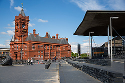 Cardiff, UK. 2nd May, 2017. The Senedd Cymru, or Welsh Parliament, stands alongside the red-brick Pierhead building on Cardiff Bay. The Senedd building was opened on 1st March 2006 and contains a debating chamber and three committee rooms for the Welsh Parliament.