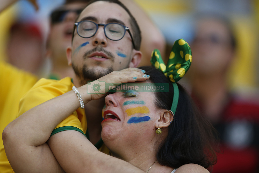 June 28, 2014 - Rio de Janeiro, Brazil - Football fans react while watching a televised match of Round of 16 between Brazil and Chile of 2014 FIFA World Cup at the Estadio do Maracana Stadium in Rio de Janeiro, Brazil, ahead of another one between Colombia and Uruguay, on Sunday. Brazil won 4-3 (3-2 in penalties) over Chile and qualified for quarter-finals on Saturday. (Credit Image: © Xinhua via ZUMA Wire)