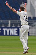 Jamie Harrison (Durham County Cricket Club) celebrates taking the wicket of Oliver Hannon-Dalby (Warwickshire County Cricket Club) to end their first innings during the LV County Championship Div 1 match between Durham County Cricket Club and Warwickshire County Cricket Club at the Emirates Durham ICG Ground, Chester-le-Street, United Kingdom on 14 July 2015. Photo by George Ledger.