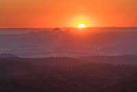 I made it to the top of this sub-peak just in time to watch the sun disappear. While the Missouri Buttes were easily visible, Devils Tower was mostly hidden in the glare of the sun.