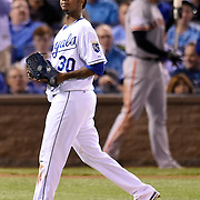 Kansas City Royals starting pitcher Yordano Ventura walked to the dugout after being relieved in the sixth inning by Kansas City Royals relief pitcher Kelvin Herrera in Game 2 of the World Series on Wednesday, October 22, 2014, at Kauffman Stadium in Kansas City, Mo.