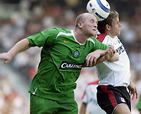 Fotball<br /> England 2005/2006<br /> Foto: SBI/Digitalsport<br /> NORWAY ONLY<br /> <br /> 16/07/05.<br /> Fulham v Celtic<br /> Pre season friendly<br /> <br /> Fulham's Moritz Volz and Celtic's John Hartson compete for the ball.