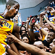 3/2/13 8:05:56 PM --- BASKETBALL SPORTS SHOOTER ACADEMY 010 --- California State-Irvine guard Chris McNealy celebrates with fans Saturday, Mar. 2, 2013 after defeating Long Beach State 72-69 at the Bren Events Center in Irvine, Ca.  Photo by Joshua Lindsey, Sports Shooter Academy