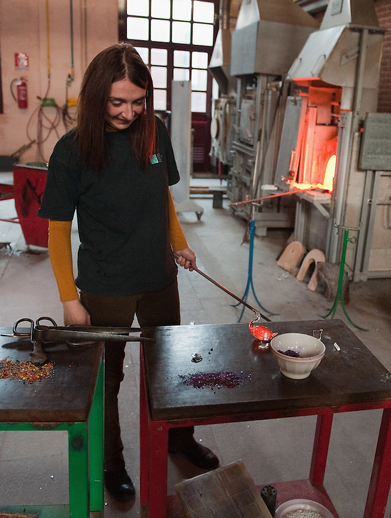 VENICE, ITALY - DECEMBER 18:  Elena Rosso a glass  artist in Murano looks at a finished glass duck still glowing on December 18, 2010 in Venice, Italy. There are only few female glass artists is Italy and they face continuous challanges in a traditionally male dominated field.
