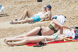 June 19, 2017 - Brighton, East Sussex, United Kingdom - Brighton, UK. Members of the public enjoy the sunshine on the beach in Brighton and Hove as the hot and sunny weather continues. (Credit Image: © Hugo Michiels/London News Pictures via ZUMA Wire)