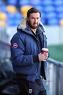 AFC Wimbledon striker Ollie Palmer (9) holding a cup of coffee during the EFL Sky Bet League 1 match between AFC Wimbledon and Hull City at Plough Lane, London, United Kingdom on 27 February 2021.