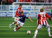 Fotball, 16. juli 2006, Tippeligaen, Tromsø IL - Vålerenga<br /> Lars Iver Strand, Tromsø, Adrian Gashi, Vålerenga<br /> Foto: Tom Benjaminsen / DIGITALSPORT