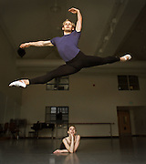 DIGITAL IMAGE. NO SHARPENING OR NOISE REDUCTION APPLIED.  <br /> Leap day story:  Seth Belliston, soloist dancer at the Pacific Northwest Ballet, leaping. Lisa Apple, PNB principal dancer, watching.<br /> <br /> 02/29/00 -- Pacific Northwest Ballet soloist Seth Belliston takes to the air above the watchful eye of PNB dancer Lisa Apple.