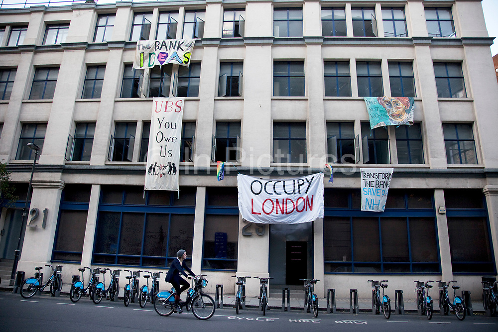 "Occupy London protesters have taken over an empty office block on the edge of The City of London, belonging to the bank UBS. An Occupy London spokesman described the new move as ""public repossession"". The building will be used for discussion to further ideas about the financial imbalance in society."