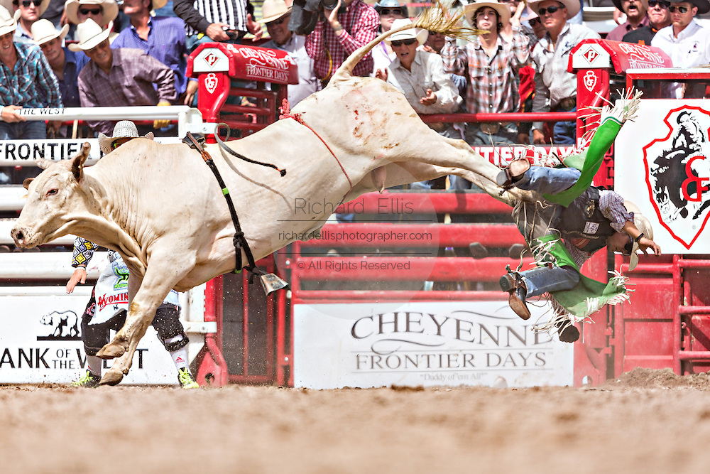 Bull rider Aaron Pass is tossed from his bull after completing his ride during the Bull Riding finals at the Cheyenne Frontier Days rodeo in Frontier Park Arena July 26, 2015 in Cheyenne, Wyoming. Pass went on to win the Bull Riding Championship.