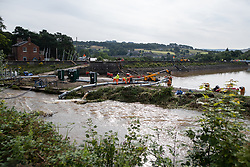 © Licensed to London News Pictures. 03/08/2019. Whaley Bridge, UK. Pumping equipment is brought in by the reservoir . The town of Whaley Bridge in Derbyshire remains evacuated after heavy rain caused damage to a slipway on the Toddbrook Reservoir , threatening homes and businesses with flooding. Photo credit: Joel Goodman/LNP