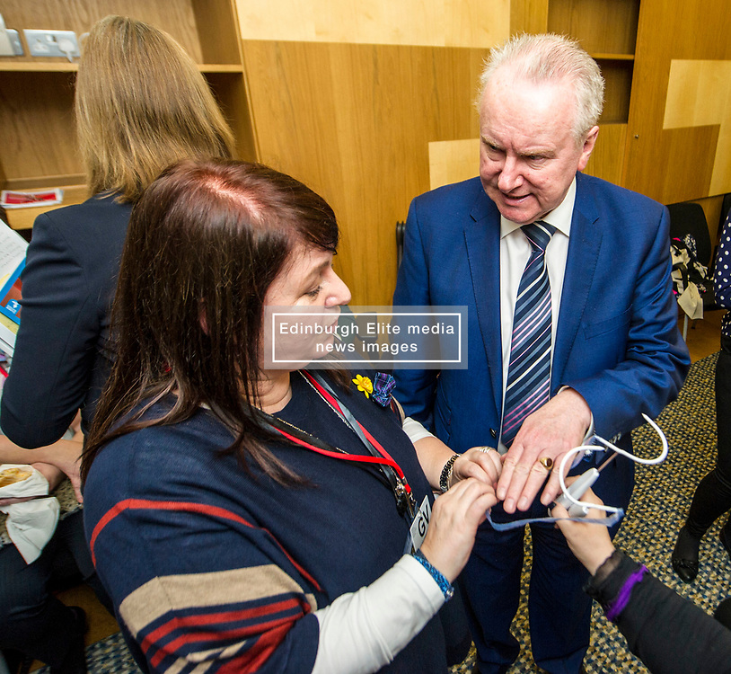 Pictured: Alex Neil MSP is shown how hard the mesh feels by Karen Neil<br /> Thousands of Scottish women have been fitted with polypropylene transvaginal mesh to treat pelvic organ prolapse or stress urinary incontinence. As a result women in every Scottish constituency have been severely injured or permanently disabled following this procedure, some have lost organs, many their careers and their relationships.  The women and their families  are asking MSPs to sign a pledge <br /> <br /> Ger Harley | EEm 16 March 2017