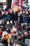 A man (centre) touches his head and cries as he performs a religious ceremony during the Imambaras observing the narration of the tragedy of Karbala in Marble Arch, central London on Sunday, Aug 30, 2020. (VXP Photo/ Vudi Xhymshiti)