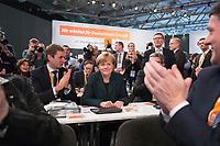 09 DEC 2014, KOELN/GERMANY:<br /> Vincent Kokert (L), CDU, Generalsekretaer der CDU MEcklenburg-Vorpommern, Angela Merkel (M), CDU, Bundeskanzlerin, und Lorenz Caffier (R verdeckt), CDU Landesvorsitzender Mecklenburg-Vorpommern, vor der Bekanntgabe des Wahlergebnisses ihrer Wiederwahl zur Bundesvorsitzenden der CDU, CDU Bundesparteitag, Messe Koeln<br /> IMAGE: 20141209-01-089<br /> KEYWORDS: Wahl, Wahlergebnis, Party Congress