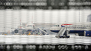 © Licensed to London News Pictures. 05/02/2012, London, UK. A plane leaves the taxi area.  Planes in the snow at Heathrow Airport today 05/02/12. The airport has cancelled a third of its flights because of the snow. Heavy snow has fallen over many parts of the UK overnight. Photo credit : Stephen Simpson/LNP