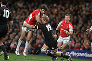 Mike Phillips of Wales runs into Daniel Braid of the Allblacks. Invesco Perpetual match, Wales v New Zealand at the Millennium stadium in Cardiff on Sat 27th Nov 2010.  pic by Andrew Orchard, Andrew Orchard sports photography,