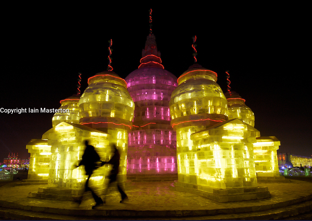 Illuminated ice castle sculpture at night at annual Harbin Ice sculpture festival in northern China