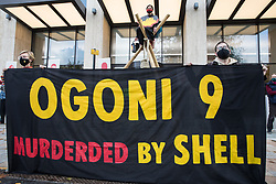 London, UK. 10th November, 2020. Environmental activists from Extinction Rebellion protest using a tripod and noose outside the Shell Centre on the 25th anniversary of the killings of the Ogoni Nine. The Ogoni Nine, leaders of the Movement for the Survival of the Ogoni People (MOSOP) including activist Ken Saro-Wiwa, were executed by the Nigerian government in 1995 after having led a series of peaceful marches involving an estimated 300,000 Ogoni people against the environmental degradation of the land and waters of Ogoniland by Shell and to demand both a share of oil revenue and greater political autonomy.