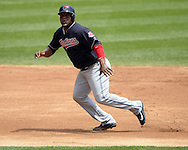 CHICAGO - MAY 25:  Juan Uribe #4 of the Cleveland Indians runs the bases against the Chicago White Sox on May 25, 2016 at U.S. Cellular Field in Chicago, Illinois.  The Indians defeated the White Sox 4-3.  (Photo by Ron Vesely)    Subject:  Juan Uribe