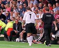 Injured new signing Harry Kewell walks past Liverpool Manager Gerard Houllier. Crewe v Liverpool. Pre season friendly match. 19/7/2003. Credit : Colorsport/Andrew Cowie.