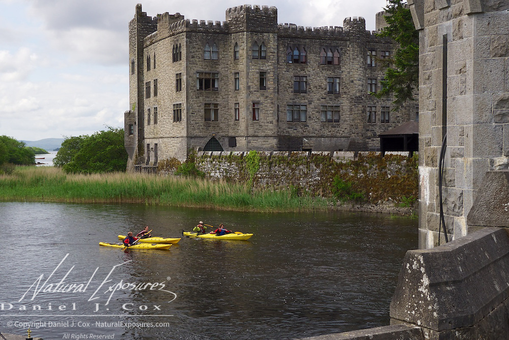 Kayakers on the river near Ashford Castle, Ireland.