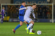 AFC Wimbledon midfielder Anthony Hartigan (8) battles for possession with Peterborough United attacker Callum Cooke (14) during the EFL Sky Bet League 1 match between AFC Wimbledon and Peterborough United at the Cherry Red Records Stadium, Kingston, England on 12 March 2019.