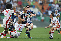 Schalk Burger of the Stormers is tackled by Beau Robinson during the Super Rugby (Super 15) fixture between DHL Stormers and the Reds played at DHL Newlands in Cape Town, South Africa on 9 April 2011. Photo by Jacques Rossouw/SPORTZPICS