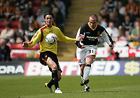 Photo: Lee Earle.<br /> Watford v Hull. Coca Cola Championship. 30/04/2006. Hull's Alan Rogers (R) clears from Chris Eagles.