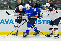 Bostjan Golicic of Slovenia between John Moore jr. of USA and Mark Arcobello of USA during Ice Hockey match between Slovenia and USA at Day 10 in Group B of 2015 IIHF World Championship, on May 10, 2015 in CEZ Arena, Ostrava, Czech Republic. Photo by Vid Ponikvar / Sportida