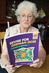 Older Woman revising for her German GCSE,